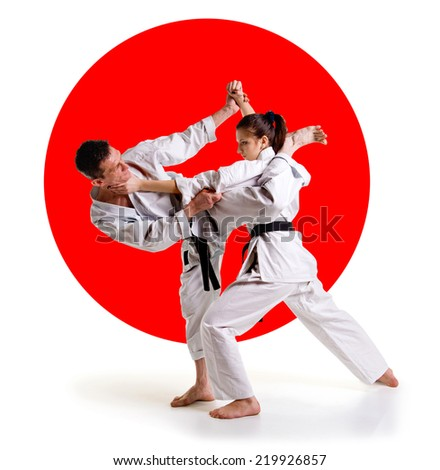 Martial arts master.Karate athletes on the background of the Japanese flag on a  white background.Sports Scramble.  - stock photo