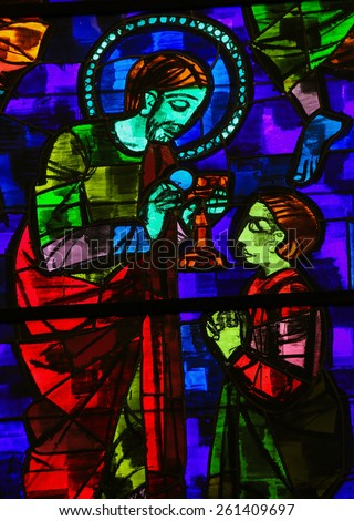 MARTINA FRANCA, ITALY - MARCH 15, 2015: Stained glass window depicting Jesus Christ giving communion in the Church of Martina Franca, Apulia, Italy. - stock photo