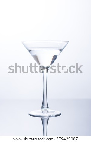 martini glass for drinking alcohol out of - stock photo