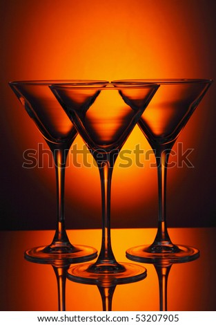 Martini glass isolated on a red background. - stock photo