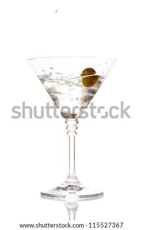 Martini glass with olive isolated on white - stock photo