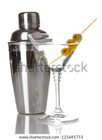 Martini glass with olives and shaker isolated on white - stock photo