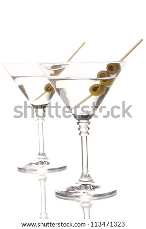 Martini glasses and olives isolated on white - stock photo