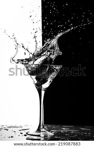 martini splash on a black-white background - stock photo