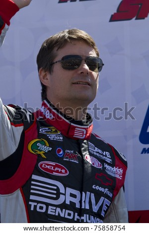 MARTINSVILLE, VIRGINIA - APRIL 3:  NASCAR driver Jeff Gordon acknowledges fans during driver introductions on April 3, 2011 at Martinsville Speedway, Martinsville, VA. Gordon finished fifth. - stock photo