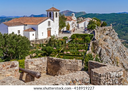 Marvao, Portugal. July 24, 2015: View of the village, Santa Maria Church and garden from the castle tower. Alto Alentejo, Portugal. Marvao was a candidate to World Heritage Site by UNESCO. - stock photo