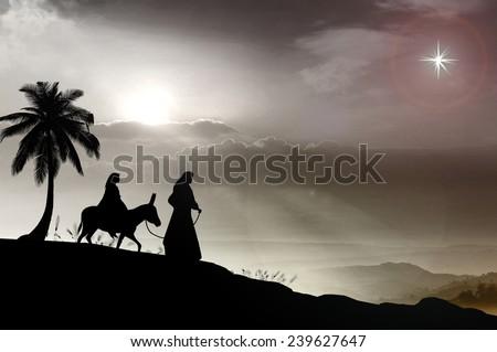 Mary and Joseph with a donkey on Christmas Eve. Bethlehem city in the background. Nativity scene story, Happy Birthday concept. - stock photo