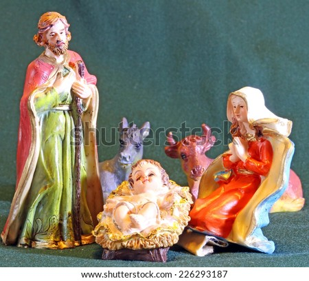 Mary and Joseph with the child Jesus in the Manger of the crib at Christmas - stock photo