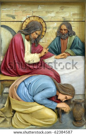 Mary Magdalene washes the feet of Jesus - stock photo
