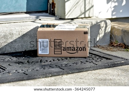 MARYLAND, USA - JANUARY 18, 2016: Image of Amazon packages delivered to a home. Amazon is the largest internet based retailer in the United States. - stock photo