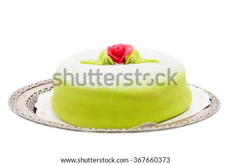 marzipan birthday cake on a silver plate isolated on white - stock photo