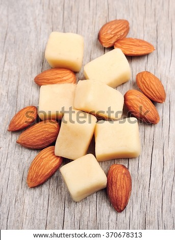 Marzipan with almonds on wooden backgrounds - stock photo