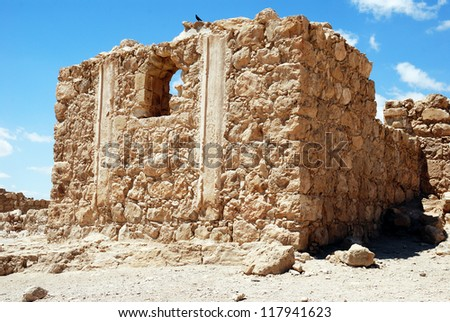 Masada - ancient  fortress in the South of Israel, on the eastern edge of the Judean Desert overlooking the Dead Sea. UNESCO World Heritage Site. - stock photo