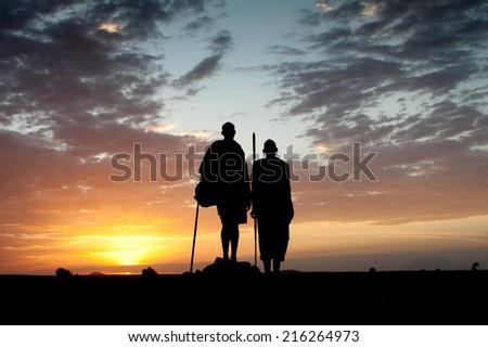 Masai and sunset - stock photo