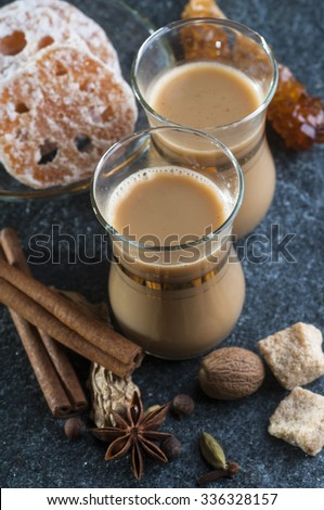 Masala tea with spices and lotus root candies  - stock photo