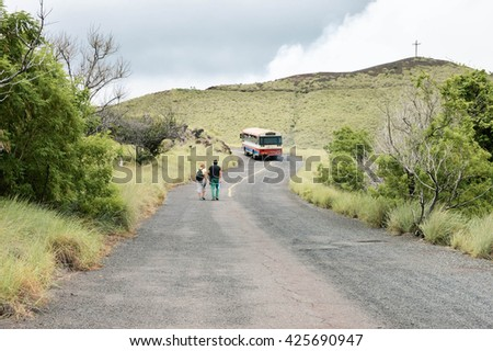 Masaya, Nicaragua - July 24, 2015:  Tourists hike up the road towards the craters of Masaya and Nindiri volcanoes on July 24, 2015 in Nicaragua - stock photo