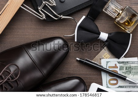 masculine accessories on the brown wooden table - stock photo