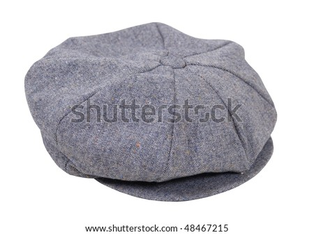 Masculine tweed flat driving cap worn on the head when out for a drive - path included - stock photo