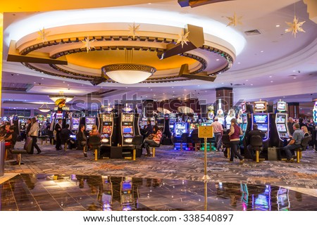 MASHANTUCKET, CT - NOVEMBER 7, 2015: View of people gambling at slot machines at Foxwoods Casino.  - stock photo