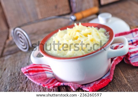 mashed potato in bowl and on a table - stock photo