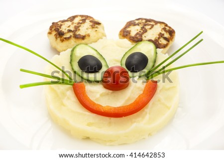 mashed potatoes in a mouse with ears of the chops - stock photo