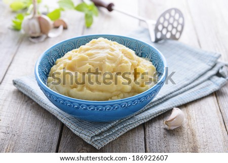 Mashed potatoes in blue bowl - stock photo