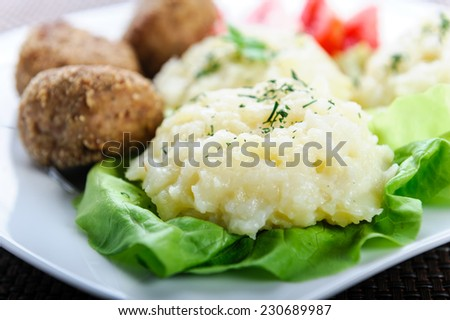 mashed potatoes on a bed of lettuce and meatball - stock photo
