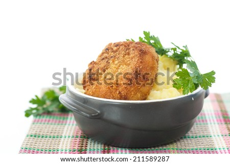 mashed potatoes with fried cutlet on a white background - stock photo
