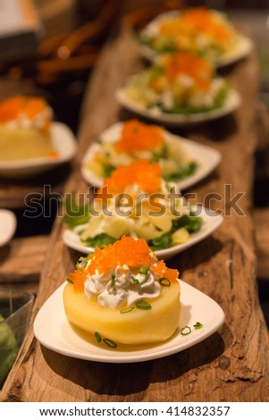 mashed potatoes with  sour cream and flying fish caviar (tobiko), canape appetizer - stock photo