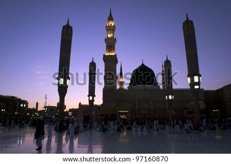 Masjid (Mosque) Nabawi at sunset in Al Madinah, Kingdom of Saudi Arabia. - stock photo