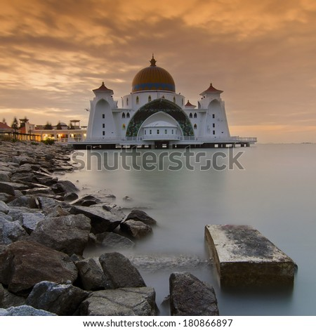 Masjid Selat Melaka, Malaysia. Masjid Selat Melaka is a mosque located on Malacca Island near Malacca Town in Malacca state, Malaysia. It looks like a floating structure if the water level is high. - stock photo