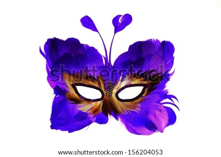 Mask of a butterfly on a human face, from feathers of blue color, for holidays and the carnivals, isolated on a white background - stock photo