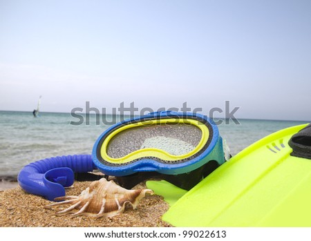 mask, snorkel and fins for snorkeling at the beach - stock photo