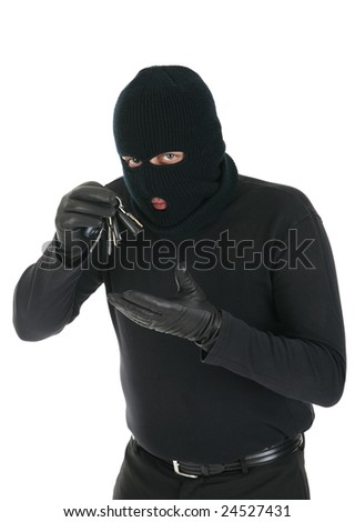 Masked criminal stealing house keys - isolated over the white background - stock photo