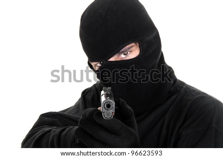 Masked man aims with gun , selective focus - stock photo