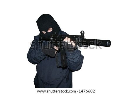 masked terrorist about to fire a machine gun - stock photo
