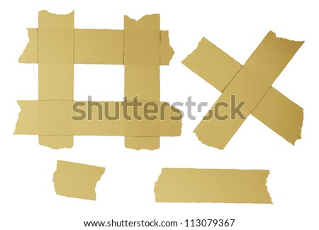 Masking tape torn strips of isolated elements of strong adhesive beige paper material as office supplies used in packaging boxes or repairing or fixing broken things that need to be sealed air tight. - stock photo