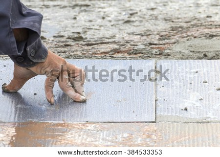Mason was repaired for the floor tiles - stock photo