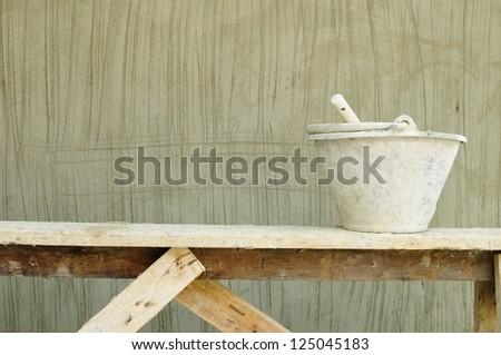 Masonry motar wall and equipment - stock photo