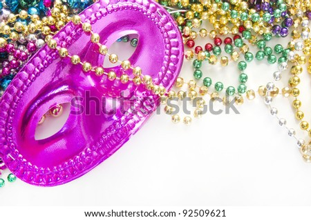 Masquerade mess on beads after party - stock photo