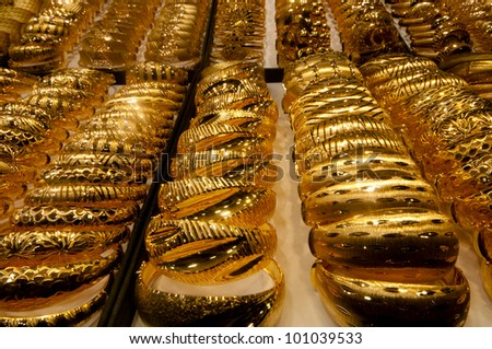 Mass of heavy gold bracelets in the Grand Bazaar, Istanbul. - stock photo