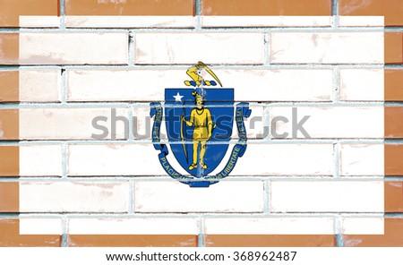 Massachusetts state flag of America on brick wall - stock photo