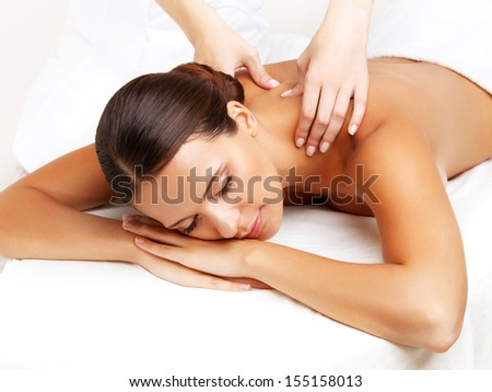 Massage. Close-up of a Beautiful Woman Getting Spa Treatment - stock photo