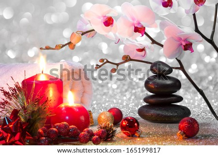 massage composition christmas spa with candles, orchids and black stones - stock photo