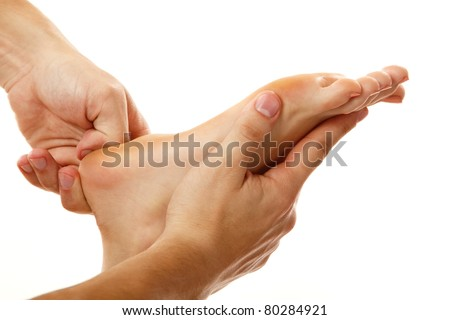 massage foot female close-up isolated on white background - stock photo