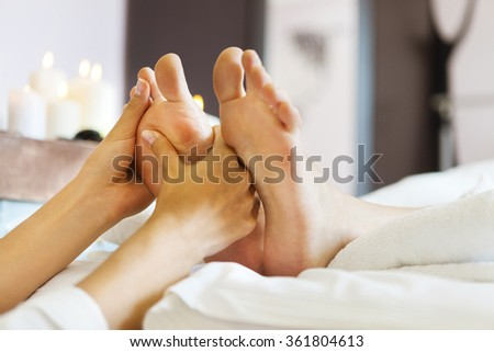 Massage of human foot in spa salon. Close up - stock photo