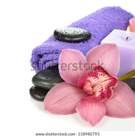 Massage stones and orchid on a white background - stock photo