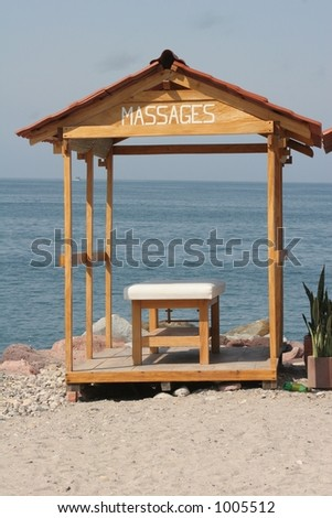 Massage table at beach - stock photo