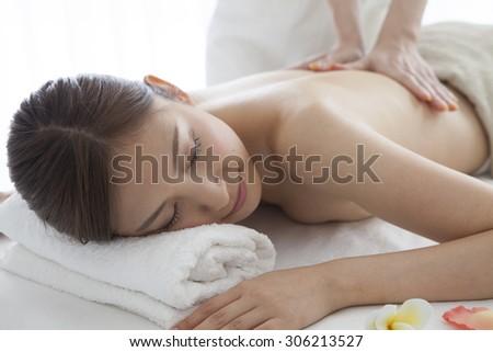 Massage woman young beautiful cheerful - stock photo