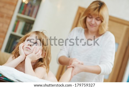 Masseur making a massage to child leg foot and body - stock photo